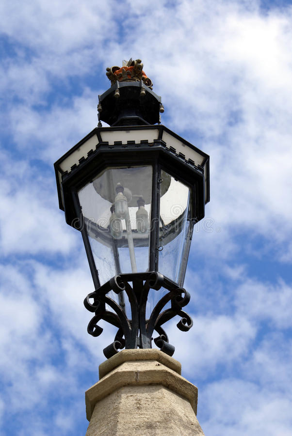 Lamp. light. Electric or electrical lamp or light on a gate post stock photo