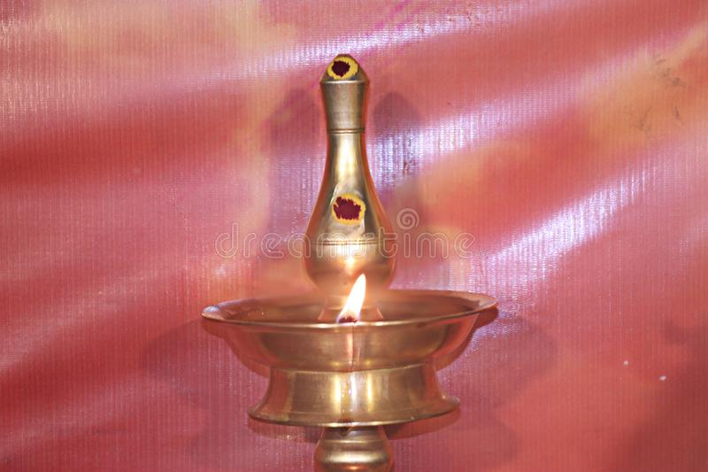 Lighted lamp for prayer. Lamp lit for prayer in a Hindu temple or home. Lighting a lamp is believed to be auspicious in Hindu culture and religion stock image