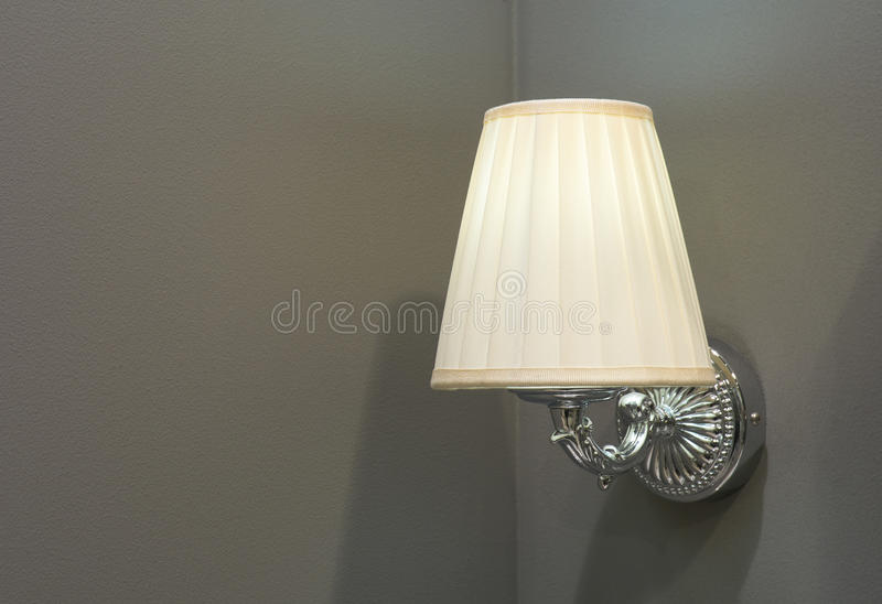 Lamp mounted on the wall royalty free stock photography