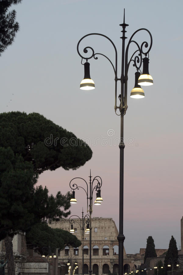 Street Lights Near Colosseum At Sunset In Rome Italy Stock Photo
