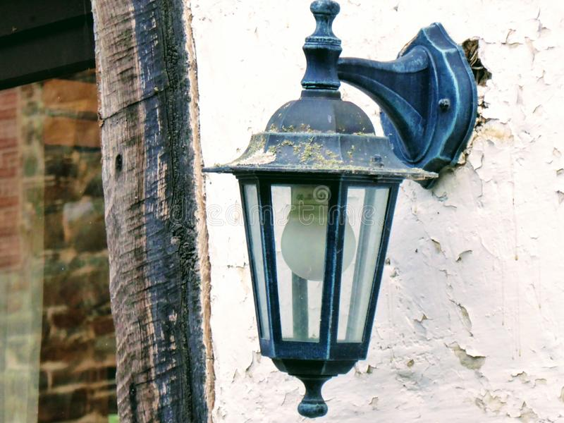 Lamp on old wall on house, street light. royalty free stock photos