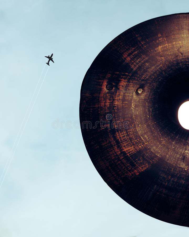 Lamp and plane flying in the sky stock photography
