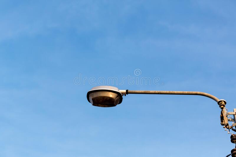 Lamp and pole in the garden park and blue sky background. Electrical light in the night. image for background, wallpaper and objects royalty free stock photography