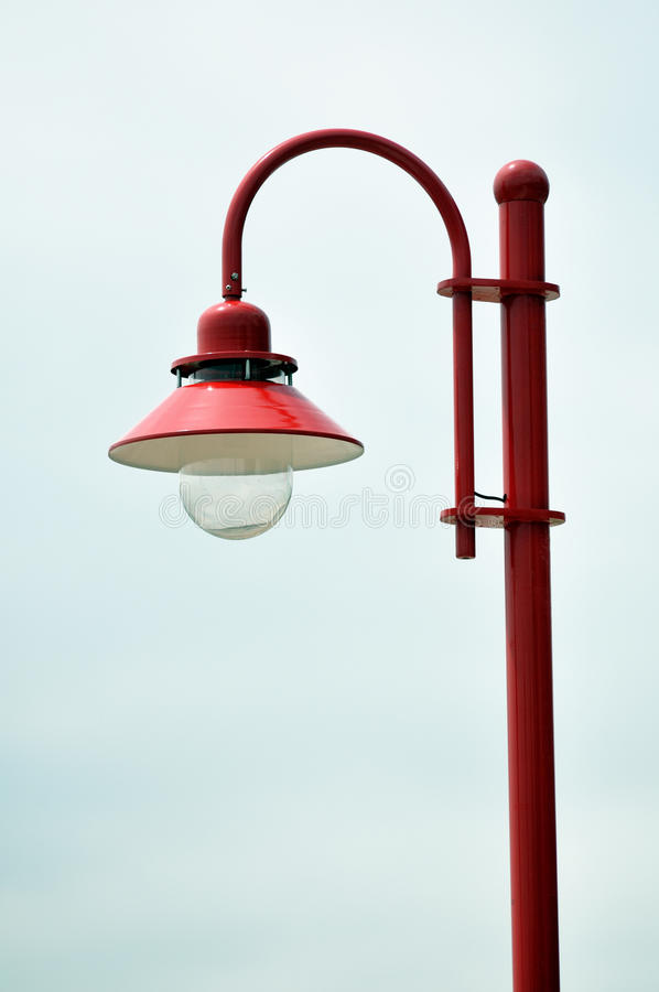 Lamp post. New red lamp post against white sky background royalty free stock photography
