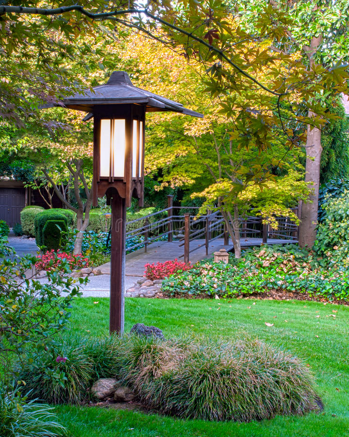 Lamp Post. Lighted Lamp post in beautiful garden stock image