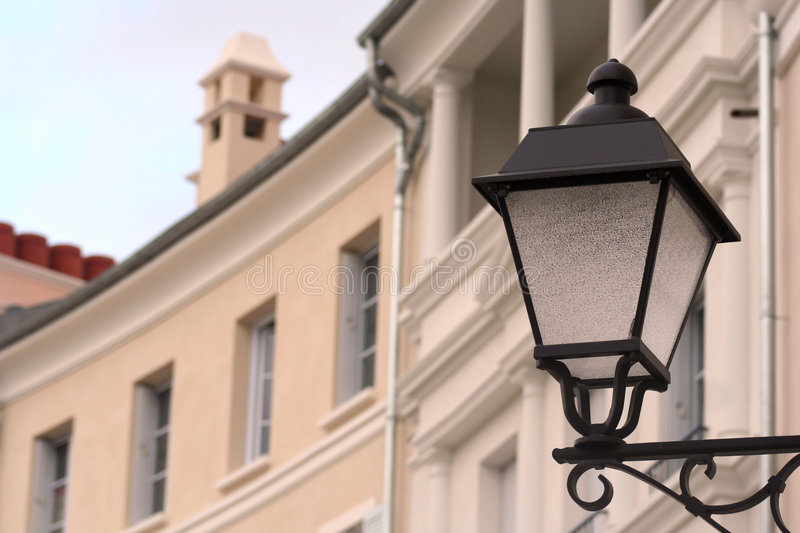 Lamp post. Classic new lamp post in front of a house stock photo