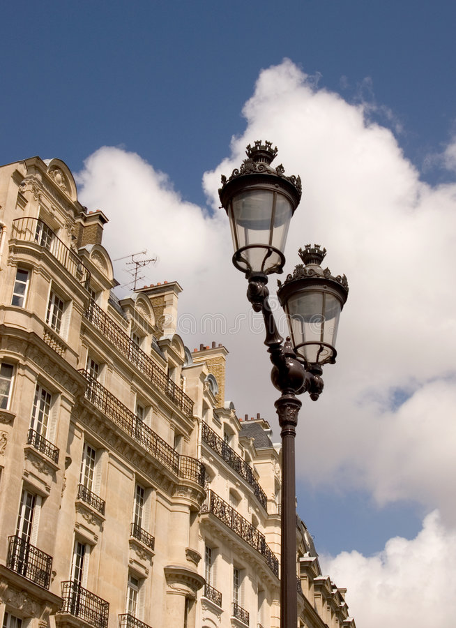 Lamp Post. A lamp post in front of apartments in Paris royalty free stock photos