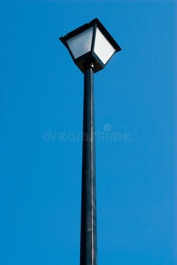 Lamp Post. Outside lamp post isolated against a blue background stock image