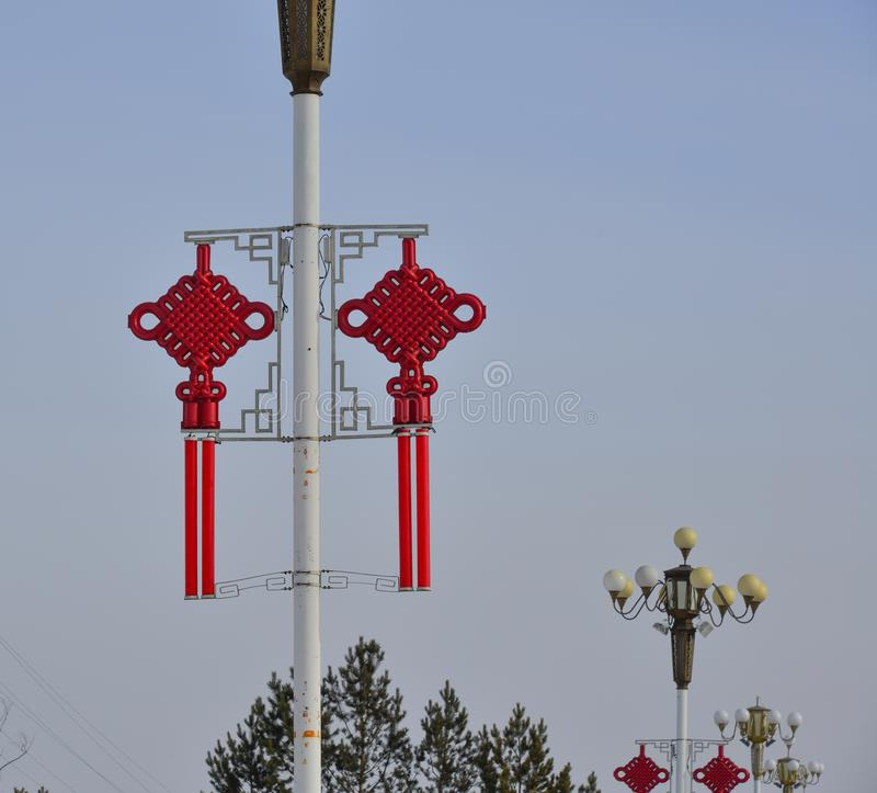 Lamp post with Chinese decorations royalty free stock photo