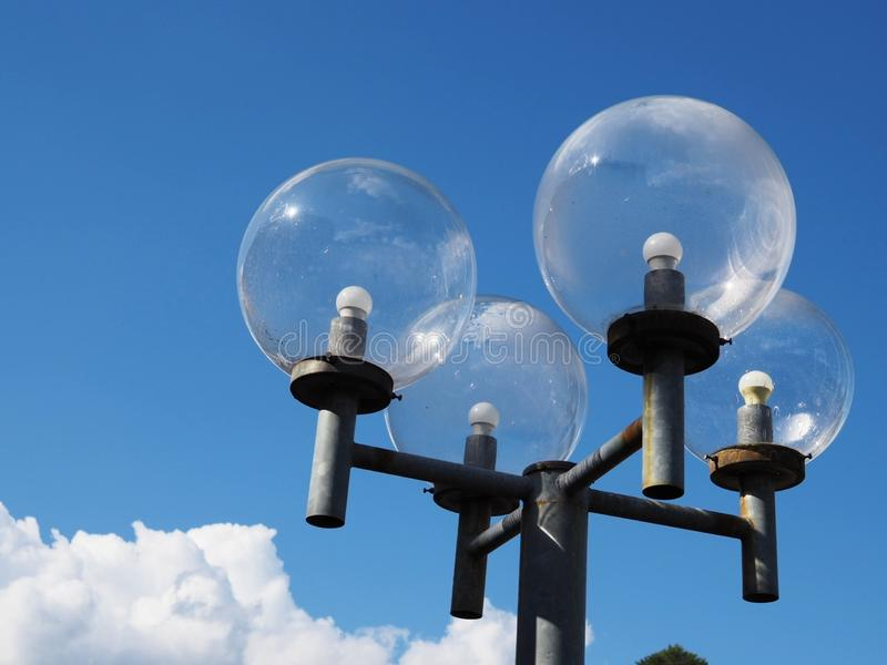 Lamp post. Against a blue sky with clouds stock photos