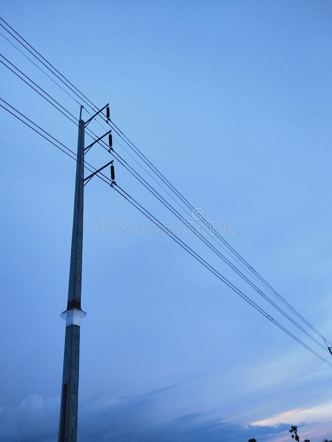 Lamp post. Wire sky cloud stock images