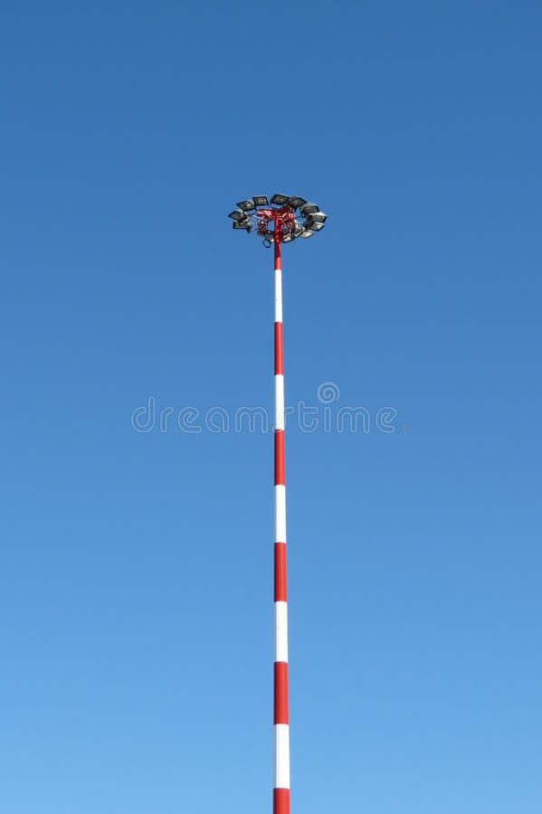 Lamp post. Near an airport with alternate red and white painting royalty free stock image