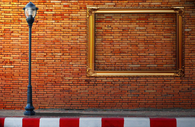 Lamp post street and frame on brick wall royalty free stock photography