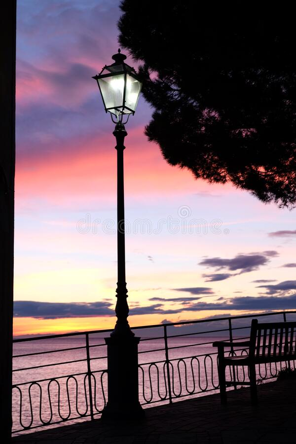 Lamp post sunset sea. Transport infrastracture, especially lamp post, featuring sunset sea royalty free stock photos