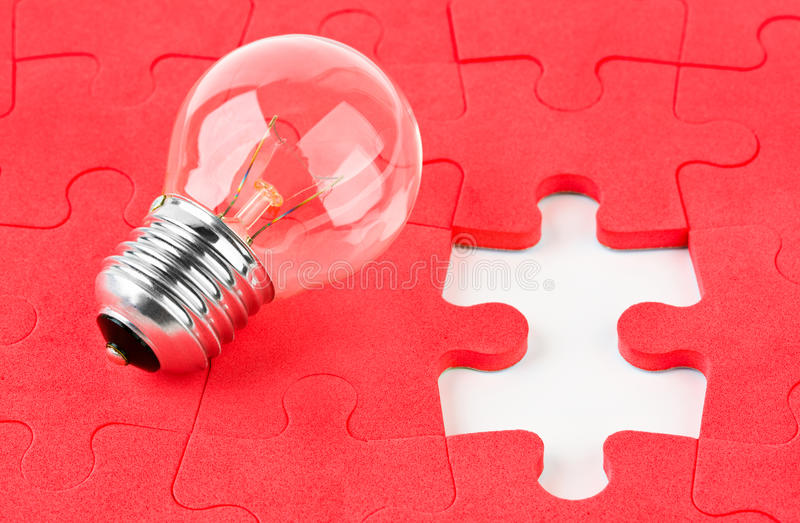 Lamp and puzzle stock photos