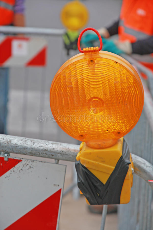 Lamp in a roadworks over the excavation
