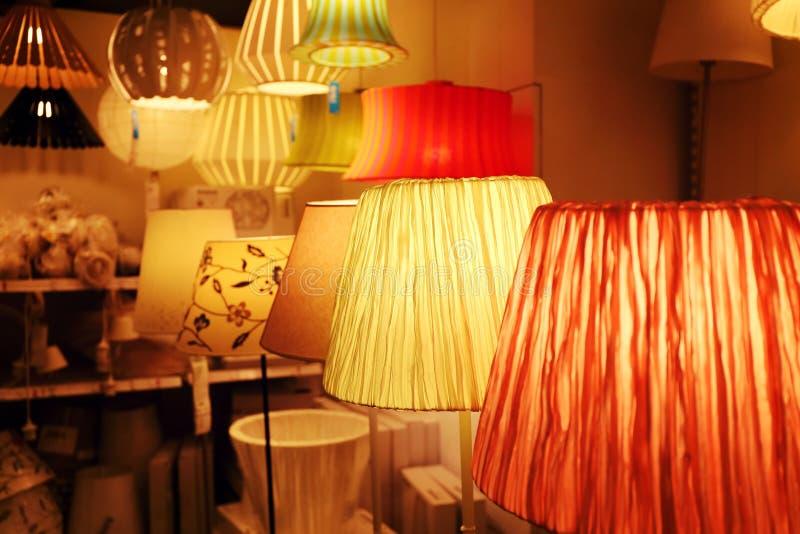Lamp store light shop indoor lighting. Many glowing lamps in lamp store at night. Light shop for indoor home decor lighting royalty free stock image