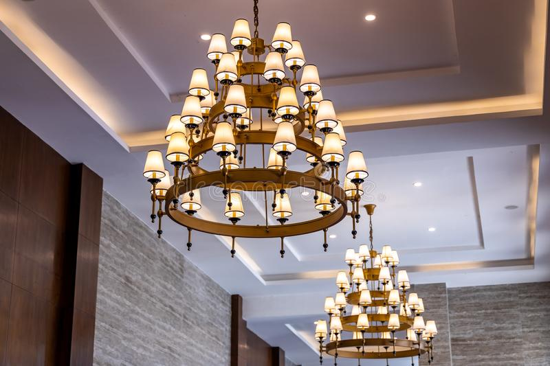 Lamp style chandelier hanging by the ceiling inside house royalty free stock photos