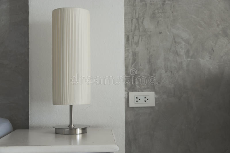 Lamp on a table bedside. Lamp on a table bedside in the bedroom royalty free stock photo