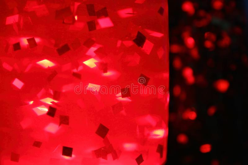 Lamp on the table with red glitter stock photos