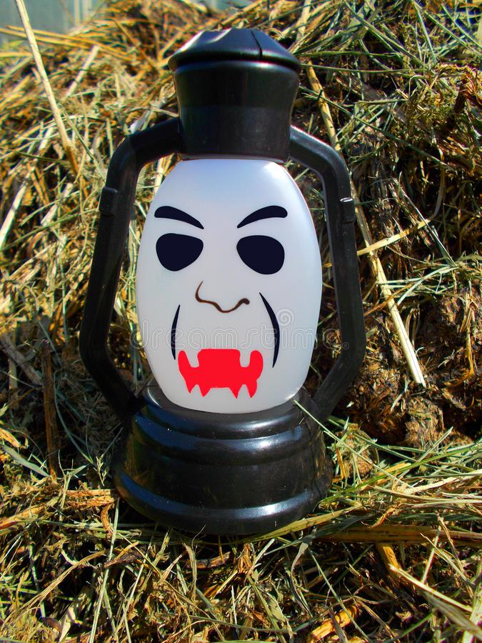 A lamp with a terrible face. Halloween. A lamp with a terrible face. A scary mug looks at you. Halloween stock photos