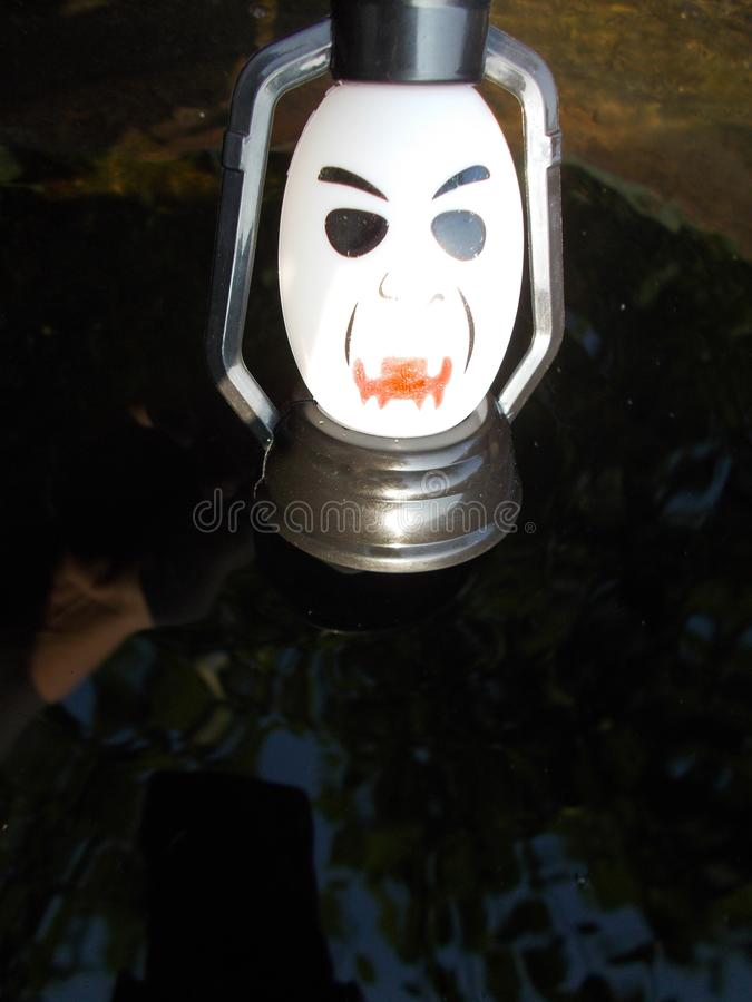 A lamp with a terrible face. Halloween. A lamp with a terrible face. A scary mug looks at you. Halloween royalty free stock images