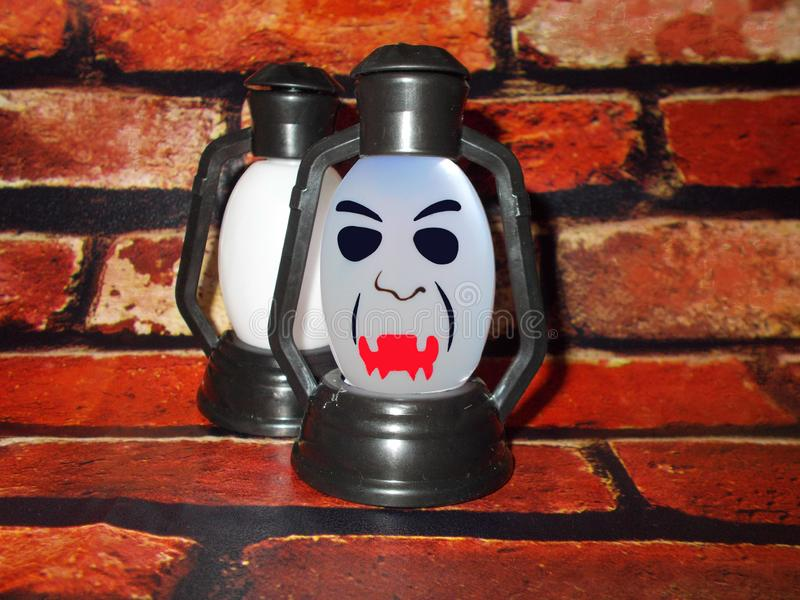 A lamp with a terrible face. Halloween. A lamp with a terrible face. A scary mug looks at you. Halloween royalty free stock photos