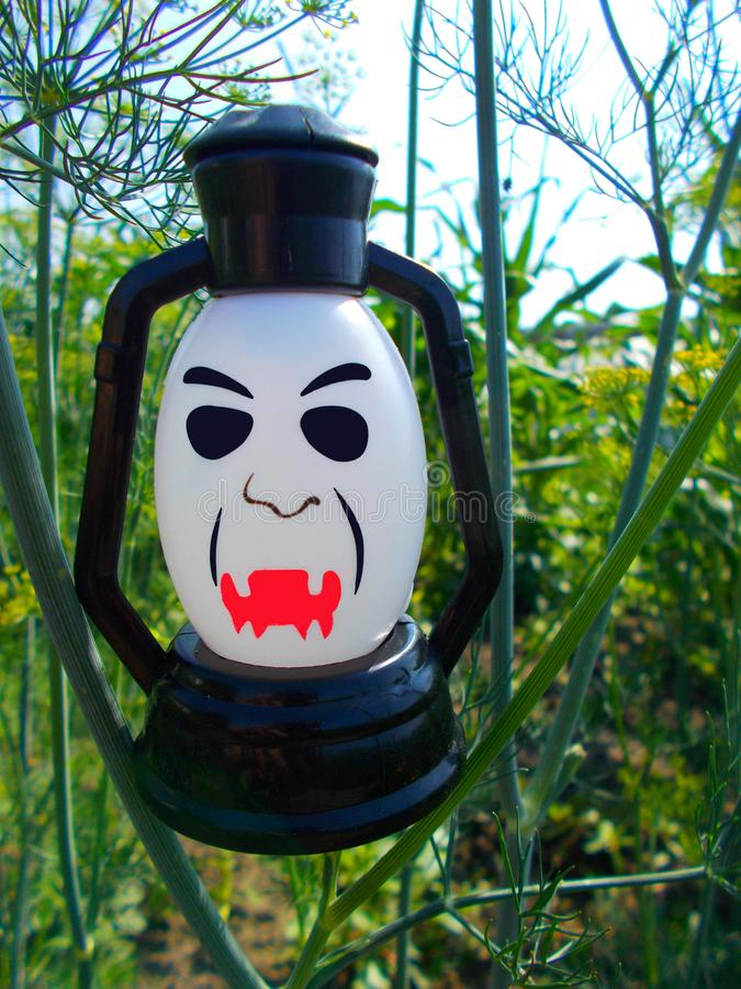 A lamp with a terrible face. Halloween. A lamp with a terrible face. A scary mug looks at you. Halloween stock images