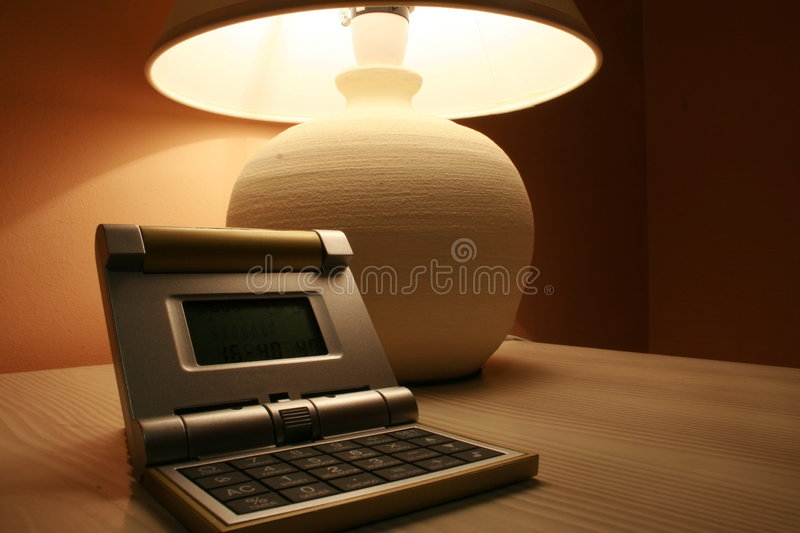 Lamp And A Travel Clock Royalty Free Stock Images