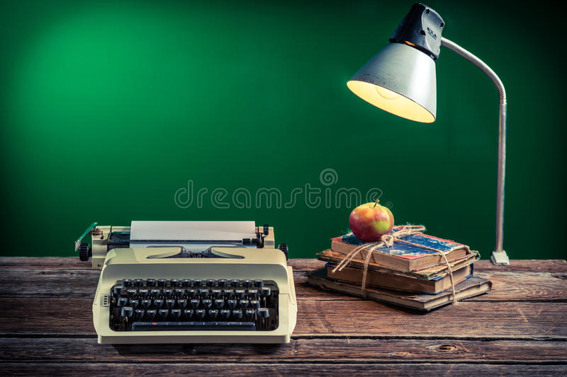 Lamp and typewriter in the classroom. Retro style stock image