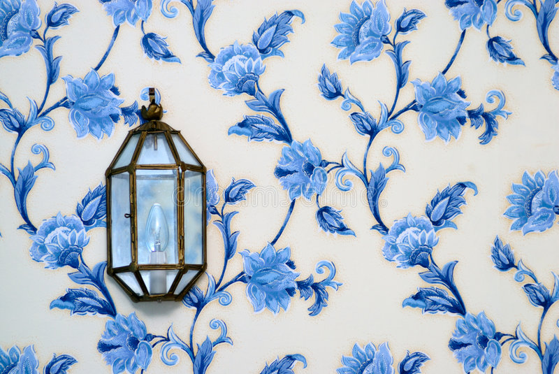 Lamp on vintage wallpaper royalty free stock photography