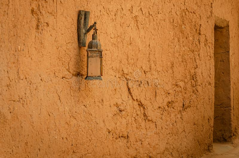 Lamp on a wall of the Kasbah Ait Ben Haddou in Ouarzazate, Morocco. Hadu, fortified, city, ksar, draa-tafilalet, africa, travel, tourism, outdoor, lifestyle royalty free stock image