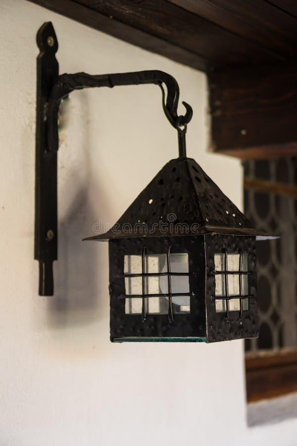 Lamp, wall lamp on a yellow wall close-up, vintage, retro royalty free stock photo