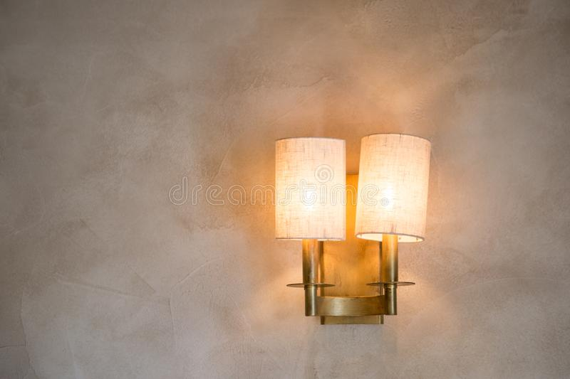 The lamp weighs on the wall included. Beautiful warm light. Wallpaper light.  royalty free stock image