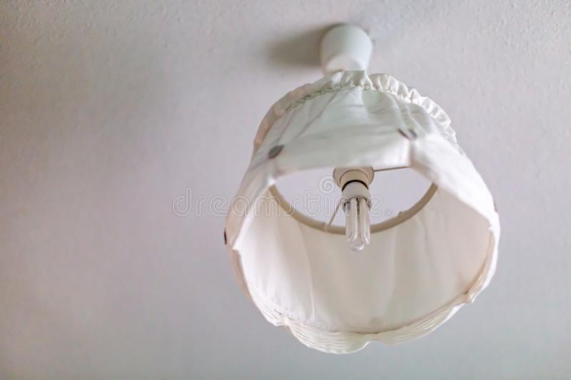 While lamp on white ceiling royalty free stock photography