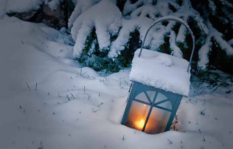 Lamp in winter in the snow stock photo