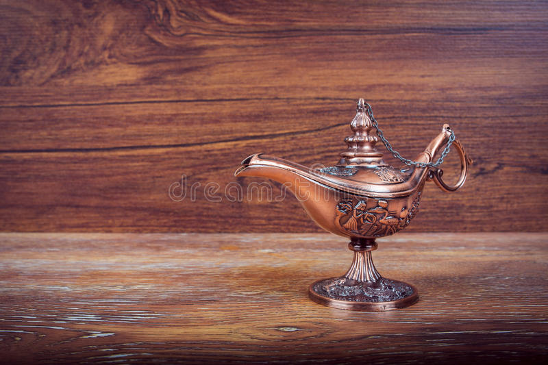 Lamp of wishes on a wooden background stock images