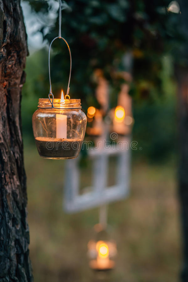 Free Lamp With Candle Is Hanging On A Tree At Night. Wedding Nigh Stock Photography - 97856242