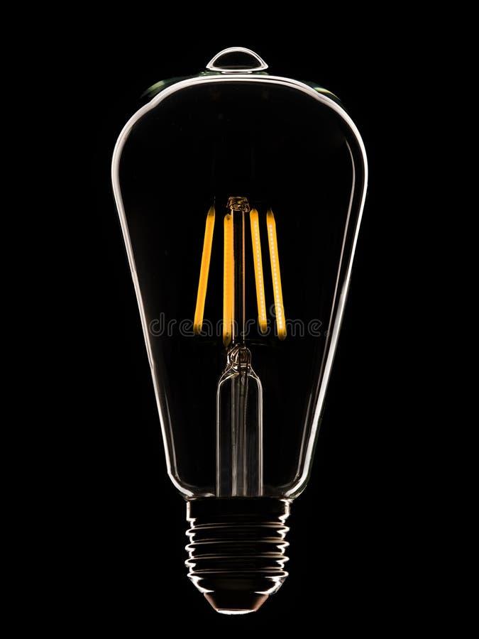 Lampada del LED sul nero immagine stock