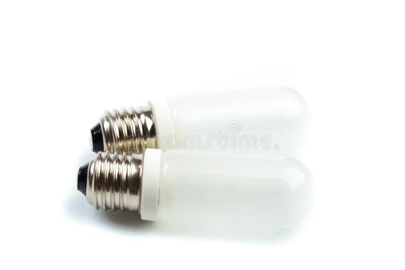 Lampada dell'alogeno su un fondo bianco Lampada per il primo piano istantaneo dello studio - Immagine fotografia stock