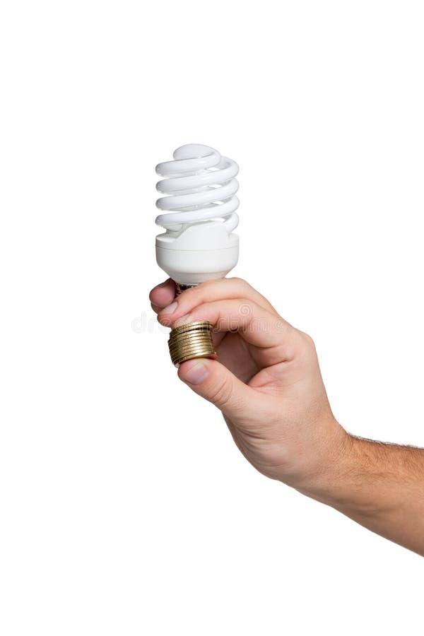 Lampada economizzatrice d'energia in mano maschio fotografie stock libere da diritti