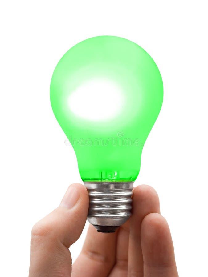 Lampada verde a disposizione immagine stock libera da diritti