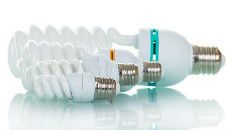 Lampade fluorescenti stabilite, isolate su fondo bianco fotografia stock