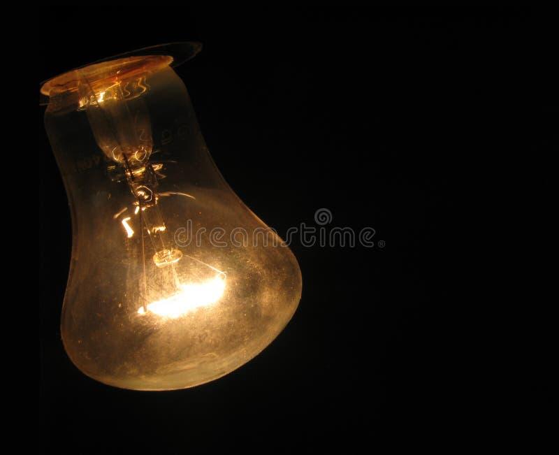 Lampadina. Esso sta emettendo luce, colore giallo polveroso & caldo. immagini stock libere da diritti