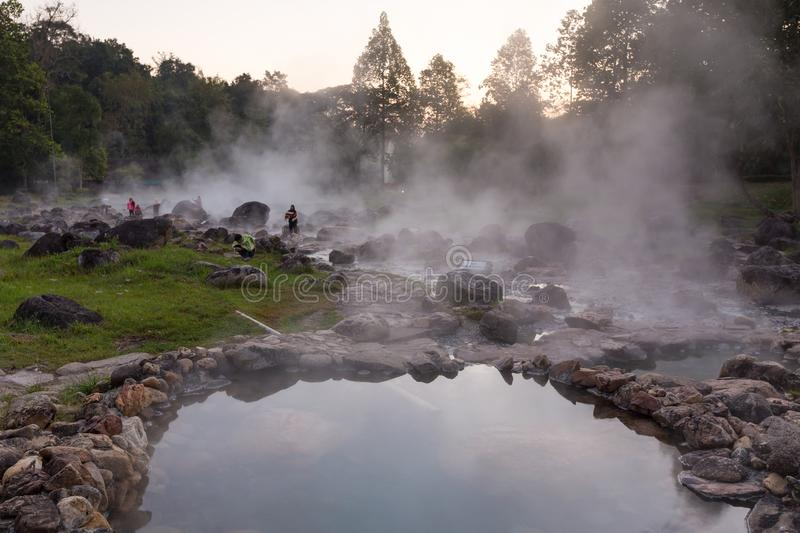 Lampang,Thailand-December 21,2017:Tourists in the Chaeson National Park,The main attraction is the hot spring with a 73 degree. Celsius water spring over rocky royalty free stock photo