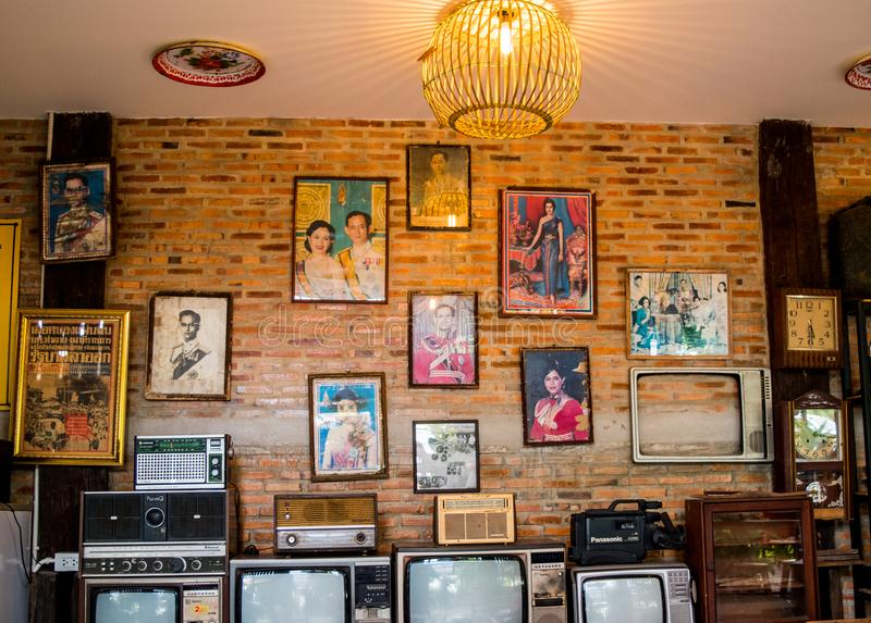 Lampang, Thailand - May 4,2018 - classic decoration, old radio, television, clocks and old picture of King Rama 9 and Queen at stock images