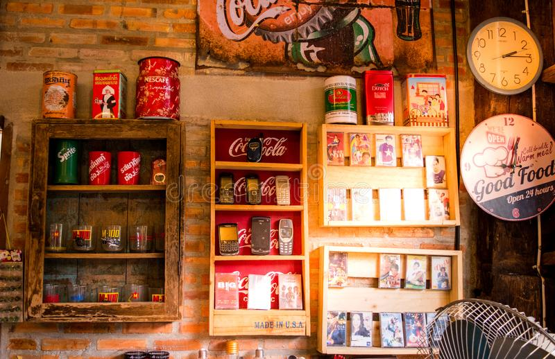 Lampang, Thailand -May 4, 2018:classic decorations, old cell phone, cassette tape, Coca-Cola can, clocks at Tontang cafe, Lampang. royalty free stock photo