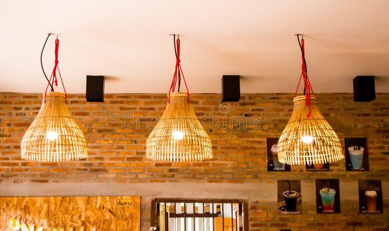 Lampang, Thailand - May 4,2018 - classic decoration, wooden lamp with drinking menu and beautiful brown brick wall atTontang cafe. stock photo