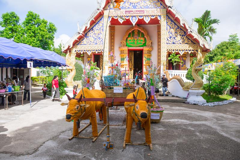 Tan Kuay Salak Festival- Northern Thai ritual that people will give foodstuff and valuable things to the temple and monks stock photo