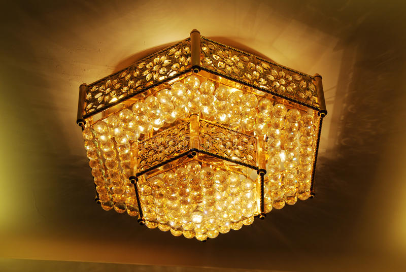 Lampe d'or d'hexagone images stock
